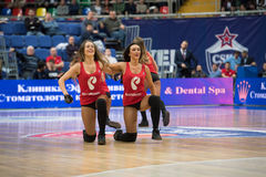 Cheerleaders of CSKA team. MOSCOW, RUSSIA - JANUARY 27, 2017: Cheerleaders of CSKA team  dance on basketball game CSKA vs Anadolu Efes on Regular championship of Royalty Free Stock Photo