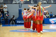 Cheerleaders are dancing on basketball court Stock Photo