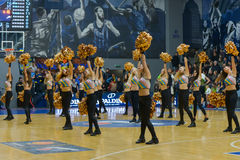 Cheerleaders are dancing on basketball court Stock Photos