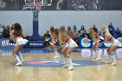 Cheerleaders are dancing on basketball court Royalty Free Stock Photos