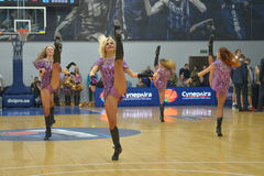 Cheerleaders are dancing on basketball court Royalty Free Stock Image