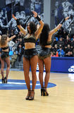 Cheerleaders are dancing on the field Royalty Free Stock Photo