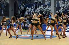 Cheerleaders are dancing on the field Stock Photo