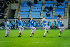 Cheerleaders are dancing on the field Royalty Free Stock Image