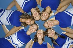 Cheerleaders Forming Huddle Stock Images
