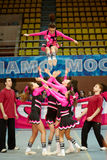 Cheerleaders girl team performs acrobatics Royalty Free Stock Image