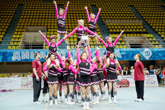 Cheerleaders girl team performs stunt Stock Photo