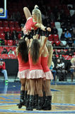 Cheerleaders hold girl on hands Stock Image