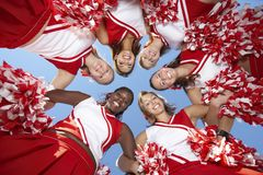 Cheerleaders in Huddle, view from below Royalty Free Stock Image