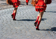 Cheerleaders marching in city street Royalty Free Stock Photography