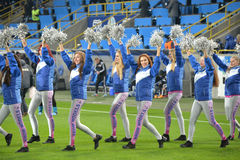 Cheerleaders out on the field Royalty Free Stock Photos
