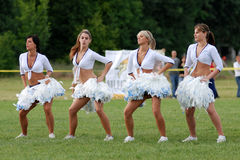 Cheerleaders perform Royalty Free Stock Images