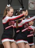 The Cheerleaders. Cheerleaders performing at a basketball game in Redding, California Royalty Free Stock Image