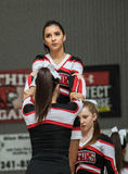The Cheerleaders. Cheerleaders performing at a basketball game in Redding, California Royalty Free Stock Images