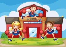 Cheerleaders performing in front of the school. Illustration of cheerleaders performing in front of the school Stock Photos
