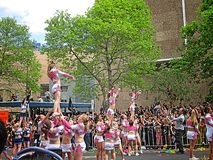 Cheerleaders Performing a Stunt. AUCKLAND- OCT. 24: Cheerleaders performing a stunt or routine during the RWC 2011 Champions parade on Oct. 24, 2011 in Auckland Stock Photos
