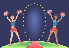 Cheerleaders with pom-poms near the stargate. Girls support dancing. Cheerleaders with pom-poms near the stargate. European girl with red hair and an African Royalty Free Stock Image