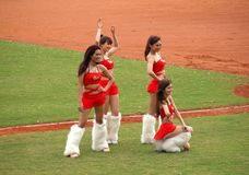 Cheerleaders Pose for the Fans Stock Photography
