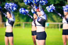 Cheerleaders Practicing. On playing field Stock Images