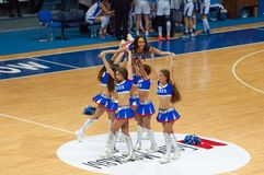 Cheerleaders pyramid. MOSCOW - DECEMBER 4, 2014: Unidentified cheerleaders in pyramid during the International Europe bascketball league match Dynamo Moscow vs Royalty Free Stock Photo