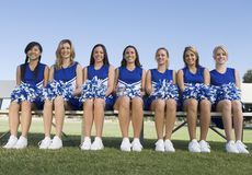 Cheerleaders sitting on bench Royalty Free Stock Photography