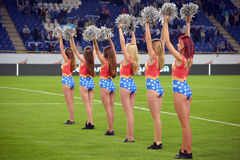 The cheerleaders standing in a row Stock Photography