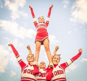 Cheerleaders team with male Coach Stock Photos