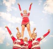 Cheerleaders team with male Coach. Artistic figure with cheerleaders team with their male Coach Stock Photos