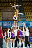 Cheerleaders team performs stunt at Championship Stock Images