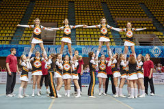 Cheerleaders team performs stunts at Championship Stock Images