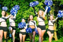 Cheerleaders Team Practicing. Cheerleaders practicing on playing field Stock Image