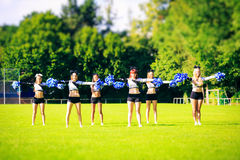 Cheerleaders Team Practicing. Cheerleaders practicing on playing field Royalty Free Stock Image