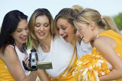 Cheerleaders Watching Video Through Handycam Stock Photography
