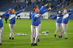 Cheerleaders are waving their hands Royalty Free Stock Photos