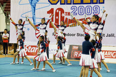 Cheerleading Championship Action. Image of a cheerleading team in action at Cheers 2009, which is the Malaysian national cheerleading championship, held at Juara Stock Images