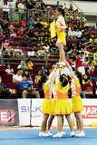 Cheerleading Championship Action. Image of a cheerleading team in action at Cheers 2009, which is the Malaysian national cheerleading championship, held at Juara Stock Photography