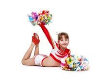 Cheerleading girl lying on floor. Young cheerleading girl with pompoms lying on the floor Royalty Free Stock Images