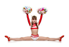 Cheerleading girl sits on splits Stock Photos