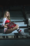 Cheerleading girl. Sitting on the stairs Stock Photos