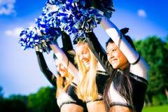 Cheerleading Team. A team of pretty, female cheerleaders having fun outdoors Royalty Free Stock Image
