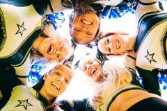 Cheerleading Team. A team of pretty, female cheerleaders having fun outdoors Royalty Free Stock Photos