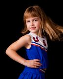 Cheerleading Twirl. Young elementary girl spinning in her cheerleading uniform Royalty Free Stock Images