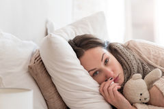 Cheerless depressed woman lying on the bed Stock Photography
