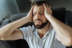 Cheerless desperate man suffering Royalty Free Stock Photography
