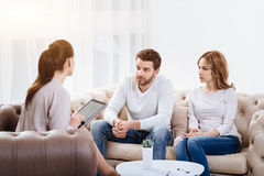 Cheerless young couple visiting a psychologist Royalty Free Stock Photo