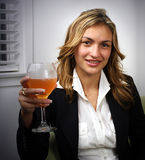 Cheers. A beautiful professional woman giving cheers royalty free stock images