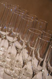 Cheers. Rows of empty champagne glasses waiting to be filled Stock Image