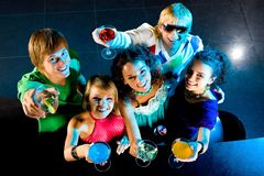 Cheers!. Above angle of happy friends cheering up at party royalty free stock images