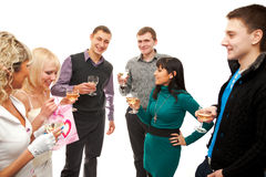 Cheers. Three young couples with glasses of champagne at a party or celebration Royalty Free Stock Photos