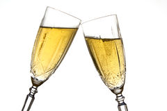 Cheers. Clinking champagne glasses against a white background Stock Photography